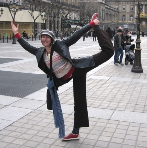 This is an image of yoga teacher Michaela Sangl doing dancer's pose in Paris.