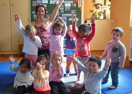 This is an image of 2-3 yr olds doing pre-school yoga.