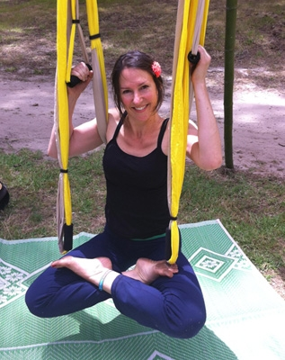 This is an image of Michaela doing aerial yoga lotus pose at Prana festival, Coromandel.