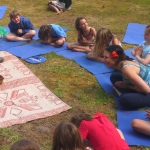 Children saying namaste in kids yoga class.