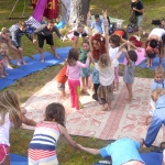 This is an image of children creating a group hibiscus yoga flower.